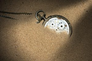 Broken Pocket Watch in the Sand